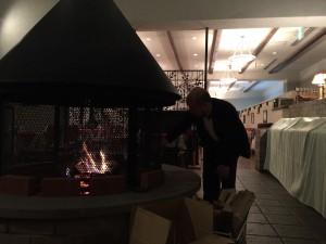 暖炉の坪倉氏